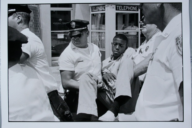 """Danny Lyon (American, b. 1942). Untitled [Eddie Brown is arrested in Albany, Georgia], 1962. 11""""x14"""". Gelatin silver print, printed 2010. Collection of Sheldron and Helen Seplowitz."""