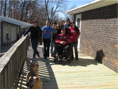 Students and homeowner after the project-Human Rights Alternative Spring Break